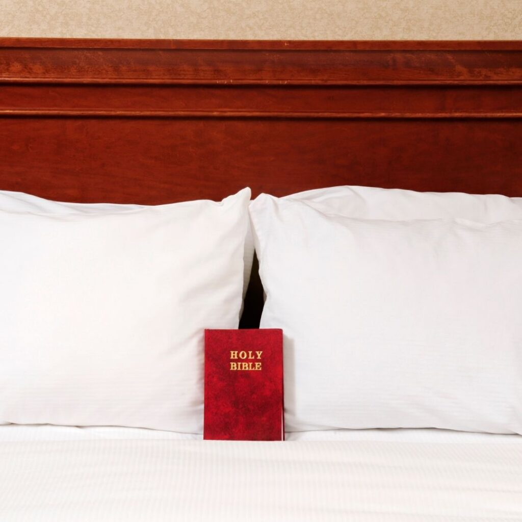 Why do hotels have bibles in them. Bible in hotel room bed